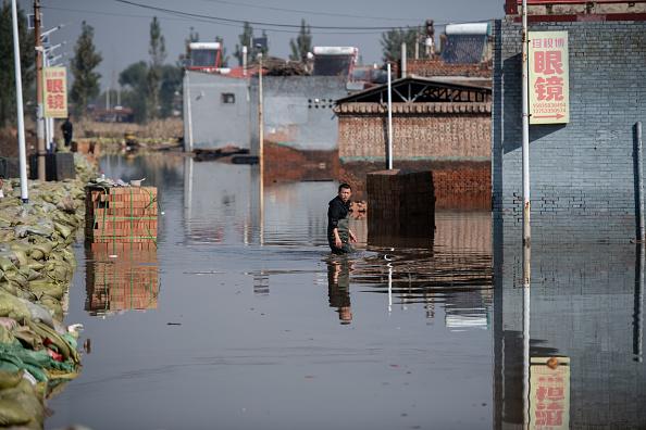 В Китае из-за мощного наводнения эвакуировано около двух млн человек: фото.Вокруг Света. Украина